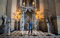 Sue Dykes puts the finishing touches to a contemporary flower display designed by Lynn Bottamley in the Great Hall ahead of the Castle Howard in Bloom Flower Festival in Yorkshire.