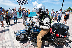 Erik Bahl riding his 1947 Harley-Davidson FL Knucklehead over the finish line of the Cross Country Chase motorcycle endurance run from Sault Sainte Marie, MI to Key West, FL. (for vintage bikes from 1930-1948). The Grand Finish in Key West's Mallory Square after the 110 mile Stage-10 ride from Miami to Key West, FL and after covering 2,368 miles of the Cross Country Chase. Sunday, September 15, 2019. Photography ©2019 Michael Lichter.