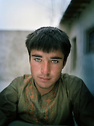 Toj Mohammed (18 years old)..Family relatives of Pir Shah Ismail in Qala-e Pinja..Winter expedition through the Wakhan Corridor and into the Afghan Pamir mountains, to document the life of the Afghan Kyrgyz tribe. January/February 2008. Afghanistan