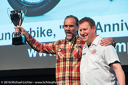 Andreas Bergerforth gets an award at the AMD World Championship of Custom Bike Building Award Ceremony on the stage in the custom dedicated Hall 10 at the Intermot Motorcycle Trade Fair. Cologne, Germany. Sunday October 9, 2016. Photography ©2016 Michael Lichter.
