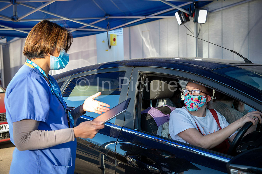 A nurse assessing a Folkestone resident at a drive through medical centre about to receive their first dose of the COVID-19 AstraZeneca Oxford vaccine in the car park of Folkestone council offices on Saturday the 27th of February 2021, Folkestone, Kent, United Kingdom.