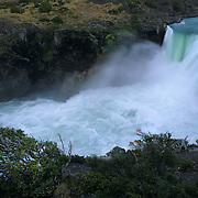 Salto Grande rushes past high in the Andes Mountains in Torres del Paine National Park, Patagonia, Chile.