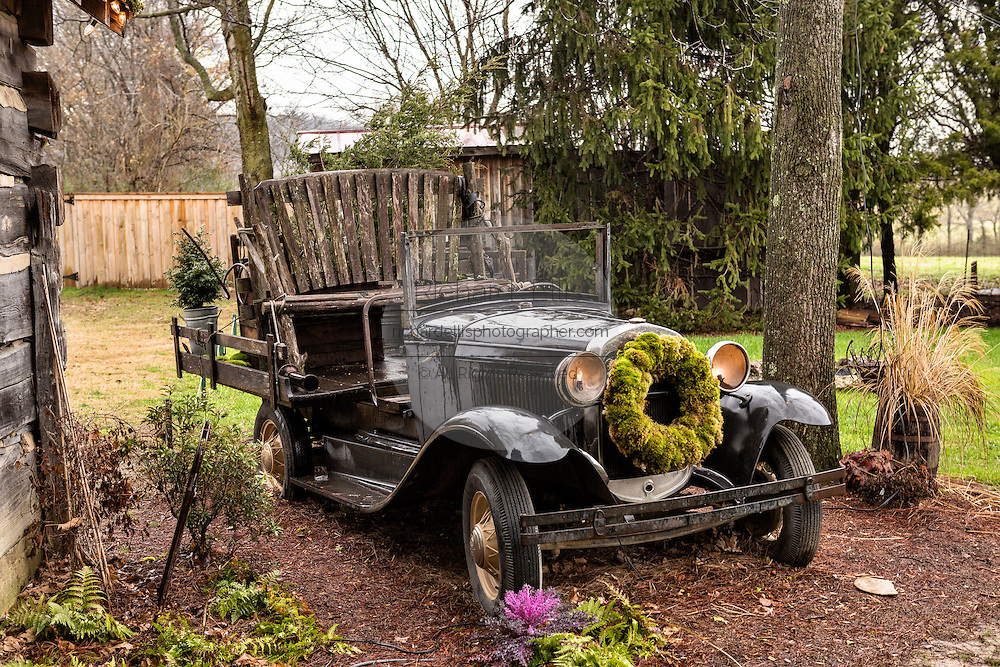 Old antique Model T Ford convertible decorated for Christmas at the Jailhouse Industry's Lawn Chair Theater in Leipers Fork, Tennessee.