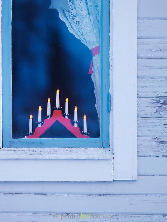 Church window in a tradition village, North Sweden, Lapland.