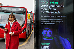 © Licensed to London News Pictures. 09/03/2020. London, UK. A woman walks past a Coronavirus public information campaign poster in London, which focuses on hand washing. Three coronavirus victims have died and 278 cases have tested positive for the virus. Photo credit: Dinendra Haria/LNP