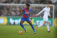 Wilfried Zaha of Crystal Palace in action.  Premier league match, Swansea city v Crystal Palace at the Liberty Stadium in Swansea, South Wales on Saturday 23rd December 2017.<br /> pic by  Andrew Orchard, Andrew Orchard sports photography.