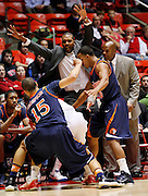 Pepperdine coaches react as a Utah player gets boxed in during the second half of an NCAA basketball game, Dec. 7, 2010 in Salt Lake City. (AP Photo/Colin E Braley)
