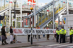 London, UK. 5 September, 2019. Metropolitan Police officers observe activists taking part in protests outside ExCel London on the fourth day of a week-long carnival of resistance against DSEI, the world's largest arms fair. The day's activities involved a Conference at the Gates themed around the arms trade in the context of state violence, with a particular focus on the issue of race.