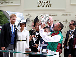 Jockey Frankie Dettori celebrates winning the St James's Palace Stakes on Without Parole as the Duke and Duchess of Sussex look on during day one of Royal Ascot at Ascot Racecourse.