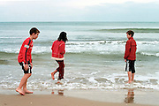 Israel, Tel Aviv, 3 children aged 10, playing on the beach on a sunny day in winter