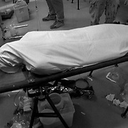 Jul 23, 2009 - Kandahar, Afghanistan - The body of a young Afghan man a seen in a Canadian front line hospital after he was fatally shot during a battle between the Afghan Army and Taliban insurgents in Zhari District, Kandahar Province, Afghanistan. The medics at this front line army hospital worked desperately to save and revive him, but the wounds were too severe for him survive..(Credit Image: © Louie Palu/ZUMA Press)