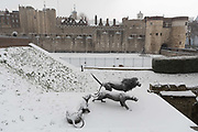 Frozen snow covered ornamental lions in front of the Tower of London during snow fall in London, England on March 2nd, 2018 as freezing weather, dubbed the Beast from the East combined with Storm Emma have brought snow and freezing weather to the UK.