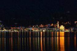 THEMENBILD - Die Lombardei ist eine norditalienische Region mit einer Fläche von 23.863 km und ca.9,8 Mio. Einwohnern. Sie ist in zwölf Provinzen aufgeteilt und liegt zwischen Lago Maggiore, Po und Gardasee. Bilder aufgenommen am 21. August 2013, im Bild Nachtaufnahme Hafenstaedtchen mit Pfarrkirche Chiesa Sancto Ambrosio, Luganersee, Lago di Lugano, Porto Ceresio // THEMES PICTURE - Lombardy is a northern Italian region with an area of 23,863 km and a population of 9,8 Mio. It is divided twelve provinces and is situated between Lake Maggiore, Lake Garda and Po. Pictured on 2013/08/21. EXPA Pictures © 2013, PhotoCredit: EXPA/ Eibner/ Michael Weber<br /> <br /> ***** ATTENTION - OUT OF GER *****