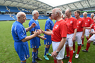 Tommy Charlton of England over 60's shaking hands with the Italy players before the world's first Walking Football International match between England and Italy at the American Express Community Stadium, Brighton and Hove, England on 13 May 2018. Picture by Graham Hunt.