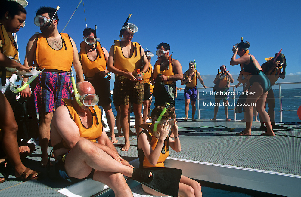 Cruise ship passengers prepare for a morning scuba-diving in the blue waters off Cancun, Gulf of Mexico.