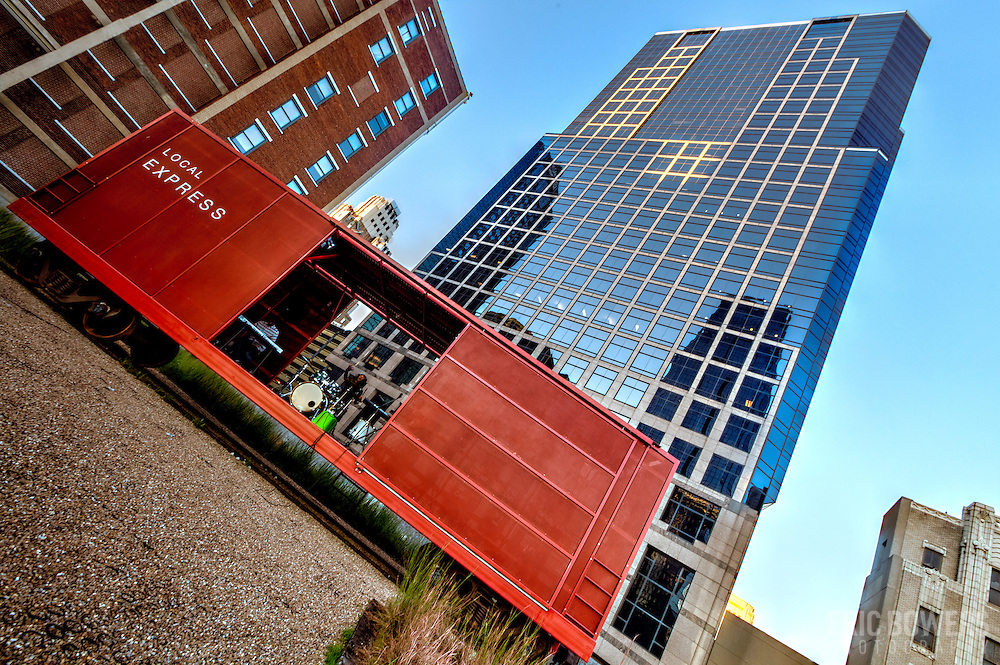 Prairie Logic boxcar performance venue at downtown Kansas City's Power and Light District, and low angle view of 1201 Walnut building.