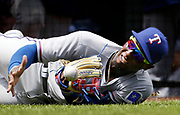 Texas Rangers third baseman Jurickson Profar is unable to hold on to a popup hit by Kansas City Royals Jarrod Dyson in the third inning of a baseball game at Kauffman Stadium in Kansas City, Mo., Sunday, July 24, 2016. (AP Photo/Colin E. Braley)