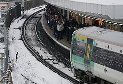 © Licensed to London News Pictures. 21/01/2013, London, UK. People wait for train on snow covered East  Croydon railway station, South London, Monday, Jan. 21, 2013. Britain is continue affect by cold weather and snow. Photo credit : Sang Tan/LNP
