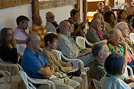 Jeffersonville, New York - People in the audience listen to a talk before a Weekend of Chamber Music concert at the Eddie Adams Barn on July 97, 2014. The event was part of the Weekend of Chamber Music's Summer Festival.