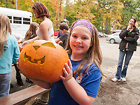 Isabelle finished carving one of approximately 60 pumpkins to be added to the Pumpkin Fest tally from the Laconia Boys and Girls Club on Tuesday afternoon.   (Karen Bobotas/for the Laconia Daily Sun)