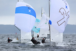 The Flying Dutchman World Championships,  Largs 2014. First days racing in breezy conditions on the Clyde. <br /> <br /> Fleet of FD's sailing downwind with<br /> Hungarians, HUN 70,  Szabolcs Majthényi and András Domokos<br /> <br /> <br /> The former Olympic class has attract 40 worldwide competitors to Scotland to compete. <br /> <br /> PIctures Marc Turner / PFM Pictures