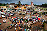 People are busy walking around a market on the island of Sao Tome, Sao Tome and Principe, (STP) a former Portuguese colony in the Gulf of Guinea, West Africa.