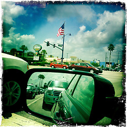 American flag, drive. Orlando holiday 2012. Photo taken with the Hipstamatic photo application on Apple iPhone 4.