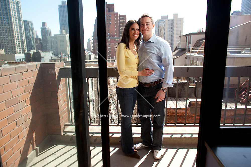 Noah Bilenker and wife Valerie Abitbol are in contract for a $1m 2-bed apt on UES that they chose over another one purely because of the school --and they don't even have kids yet.  He especially wanted to be in an established neighborhood school b/c he thinks it will be able to fight back better against city budget cuts. Photo taken in their new apartment  in New York, NY on Friday, March 20, 2009.