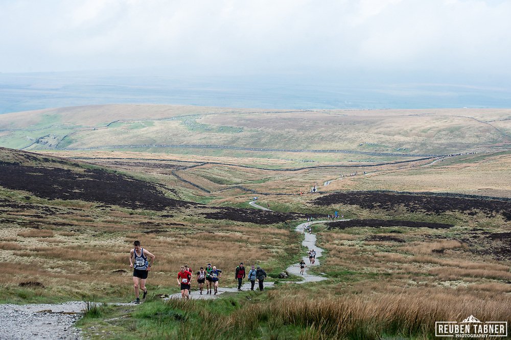 Runners wind their way up Pen-y-ghent in the Yorkshire Dales during the 60th Yorkshire Three Peaks Race.