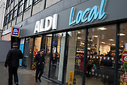 Supermarket chain Aldi Local store in Camden Town on 9th January 2020 in London, England, United Kingdom. Aldi is the common brand of two German family-owned discount supermarket chains with over 10,000 stores in 20 countries. With its low price, discount approach, Aldi is rapidly becomming serious competition to the big four supermarkets in the UK.