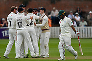 Wicket - Josh Davey of Somerset is mobbed after taking the wicket of Brett D'Oliveira of Worcestershire during the Specsavers County Champ Div 1 match between Somerset County Cricket Club and Worcestershire County Cricket Club at the Cooper Associates County Ground, Taunton, United Kingdom on 22 April 2018. Picture by Graham Hunt.