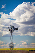 A windpump is a windmill used for pumping water, either as a source of fresh water from wells, or for draining low-lying areas of land. Once a common fixture on farms in semi-arid areas, windpumps are still used today where electric power is not available or too expensive.