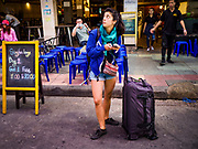 24 JULY 2018 - BANGKOK, THAILAND: A tourist on Khao San Road in Bangkok. Khao San Road is Bangkok's original backpacker district and is still a popular hub for travelers, with an active night market and many street food stalls. The Bangkok municipal government plans to shut down the street market by early August because city officials say the venders, who set up on sidewalks and public streets, pose a threat to public safety and could impede emergency vehicles. It's the latest in a series of night markets and street markets the city has closed.   PHOTO BY JACK KURTZ