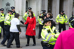 London, UK. 17 October, 2019. A Metropolitan Police officer arrests one of eight activists from Trident Ploughshares who had glued themselves together outside the Supreme Court during a protest by activists from the XR Peace group of Extinction Rebellion to highlight the Government's continuing failure to respect international law regarding arms sales on the 11th day of International Rebellion Autumn Uprising protests.