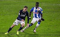 Millwall's Jed Wallace tries to flick the ball past Huddersfield Town's Naby Sarr<br /> <br /> Photographer Alex Dodd/CameraSport<br /> <br /> The EFL Sky Bet Championship - Huddersfield Town v Millwall - Wednesday 20th January 2021 - The John Smith's Stadium - Huddersfield<br /> <br /> World Copyright © 2021 CameraSport. All rights reserved. 43 Linden Ave. Countesthorpe. Leicester. England. LE8 5PG - Tel: +44 (0) 116 277 4147 - admin@camerasport.com - www.camerasport.com