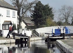 ©London News pictures. 04/03/2011. Jon Guest, British Waterway's (BW) Manager for London opens a lock gate to allow a BW work boat to pass along The Grand Union Canal towards Birmingham. A photo opportunity held today (04/03/11) at Hanwell Lock flight on the Grand Union Canal, London, as British Waterways launches a campaign to recruit volunteer lock keepers along some of London's historic canals. Picture Credit should read Stephen Simpson/LNP
