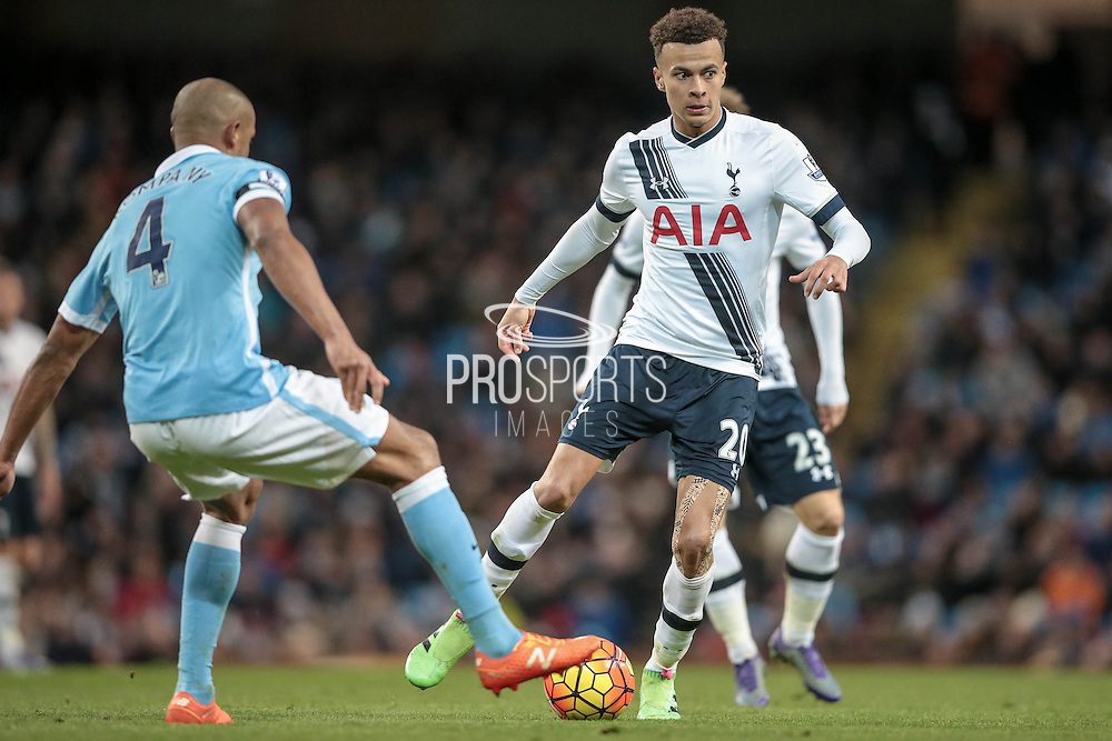 Dele Alli (Tottenham Hotspur) looks to get a pass away as Vincent Kompany (Captain) (Manchester City) moves in during the Barclays Premier League match between Manchester City and Tottenham Hotspur at the Etihad Stadium, Manchester, England on 14 February 2016. Photo by Mark P Doherty.