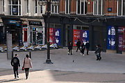With new local coronavirus lockdown measures now in place and Birmingham currently set at 'Tier 2' or 'high', people wearing face masks pass closed down shops in the city centre on 14th October 2020 in Birmingham, United Kingdom. This is the first day of the new three tier system in the UK which has levels: 'medium', which includes the rule of six, 'high', which will cover most areas under current restrictions; and 'very high' for those areas with particularly high case numbers. Meanwhile there have been calls by politicians for a 'circuit breaker' complete lockdown to be announced to help the growing spread of the Covid-19 virus.