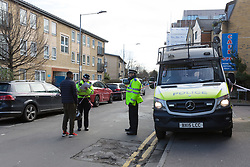 © Licensed to London News Pictures. 04/02/2018. London, UK. Police speak to a local resident at the crime scene in Abbey Road, Barking. A 19 year old man suffering stab wounds was attended to by emergency services last night and was prouncounced dead at the scene at 22:55. Photo credit: Vickie Flores/LNP
