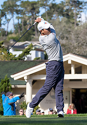 February 10, 2019 - Pebble Beach, CA, U.S. - PEBBLE BEACH, CA - FEBRUARY 10: Si Woo Kim drives off of the 1st hole tee to begin the final round of play at the AT&T Pebble Beach Pro-Am on Sunday, February 10, 2019 in Pebble Beach, CA. (Photo by Douglas Stringer/Icon Sportswire) (Credit Image: © Douglas Stringer/Icon SMI via ZUMA Press)