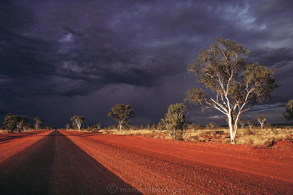 The Stuart Highway near Devil's Marbles rock formation, Northern Territory, Australia. Pentax Solar Car Race.