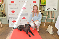 THEA DARRICOTTE and her dog Gatsby at a party hosted by Lulu Guinness and Daphne's to launch Lulu's Designer Dog Bowl and to mark Daphne's allowing dogs through it's doors, held at Daphne's, Draycott Avenue, London on 28th June 2016.