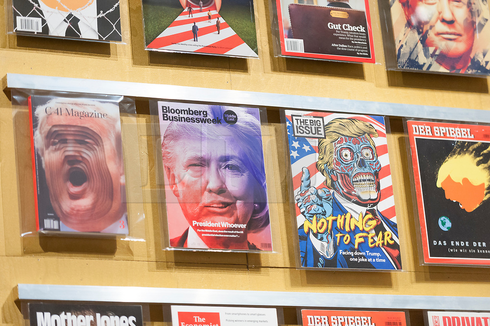 """© Licensed to London News Pictures. 27/03/2018. LONDON, UK. International magazine front covers during the Trump Clinton Presidential campaign race. Preview of """"Hope to Nope: Graphics and Politics 2008-18"""", an exhibition examining the political graphic design of a turbulent decade encompassing the 2008 financial crash, Barack Obam presidency, Brexit and Donald Trump's presidency.  The exhibition takes place at the Design Museum 28 March to 12 August 2018.  Photo credit: Stephen Chung/LNP"""
