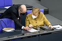 11 FEB 2021, BERLIN/GERMANY:<br /> Olaf Scholz (L), SPD, Bundesfinanzminister, und Angela Merkel (R), CDU, Bundeskanzlerin, im Gespraech, waehrend der Debatte nach Merkels Regierungserklaerung zur Bewaeltigung der Corvid-19-Pandemie, Plenum, Reichstagsgebaeude, Deutscher Bundestag<br /> IMAGE: 20210211-01-089<br /> KEYWORDS: Corona, Mundschutz, Maske, Gespräch