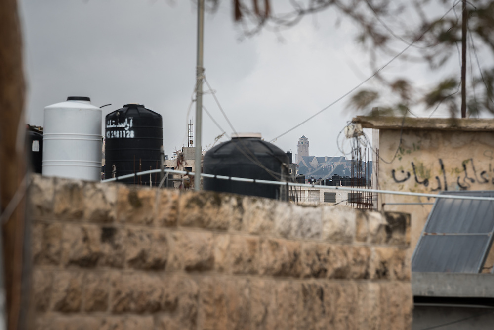 26 February 2020, Abu Dis, Palestine: The Augusta Victoria Hospital seen from Abu Dis. What used to be a 5-10 minute drive for people in Abu Dis to reach the hospital, is now a 30-40 minute detour, because of the separation wall.
