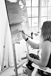 A middle aged female artist paints on a canvas in her bedroom at Fish Hoek, Cape Town, Western Cape, South Africa.(Picture: JULIAN GOLDSWAIN)