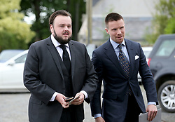 Actors John Bradley (left) and Joe Dempsie arrive at Rayne Church, Kirkton of Rayne in Aberdeenshire, for the wedding ceremony of Game Of Thrones stars Kit Harington and Rose Leslie.