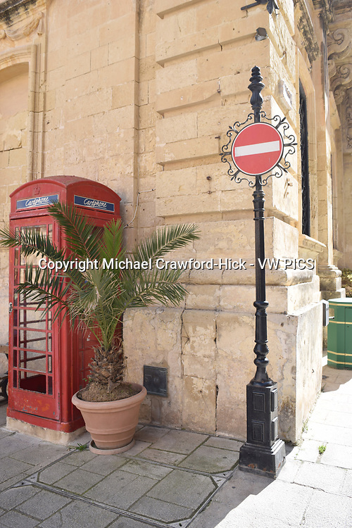 Red phone box and no entry sign in the Walled City of Rabat