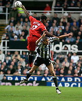 Photo. Glyn Thomas, Digitalsport<br /> Newcastle United v Fulham. FA Barclaycard Premiership. <br /> St James's Park, Newcastle. 19/01/2004.<br /> Fulham's Martin Djetou (L) fights an aerial battle for possession with Kieron Dyer.