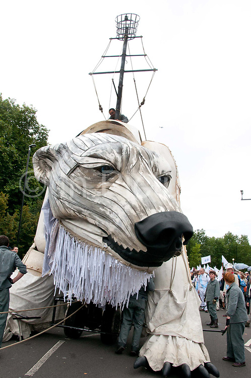 Aurora, the double-decker-bus-size polar bear puppet specially commissioned by Greenpeace to lead an Arctic-inspired street parade to the London HQ of oil giant Shell on 15 September. The three-tonne marionette bear is operated from the inside by a team of 15 puppeteers,  and  hauled on ropes by 30 volunteers along a route from Victoria Gardens to Shell's HQ at Waterloo. The giant bear, which is made of replica and reclaimed ship parts as well as recycled materials, carries in her fur the names of over 3 and half million people who have joined the global movement to protect the Arctic from industrial exploitation. This parade  was part of a global day of action to protect the Arctic withtens of thousands of people taking to the streets in over 70 cities worldwide.